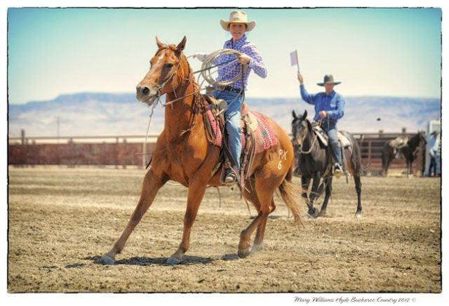A perk of Fourth of July rodeos is that moms get to rope, too! I look a little lost in this photo...I assume there is a loose cow somewhere in the nearby vicinity that I'm supposed to be roping. At any rate, it's a rare photo of me on a horse not holding a child in front of me. Well, I was four months pregnant, so I guess the child was in the picture, just not really pictured. I'm so confused right now. I'm just going to stop.